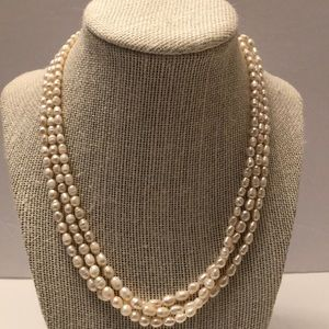 Antique triple strand natural pearl necklace